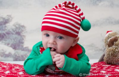Baby in Christmas clothes